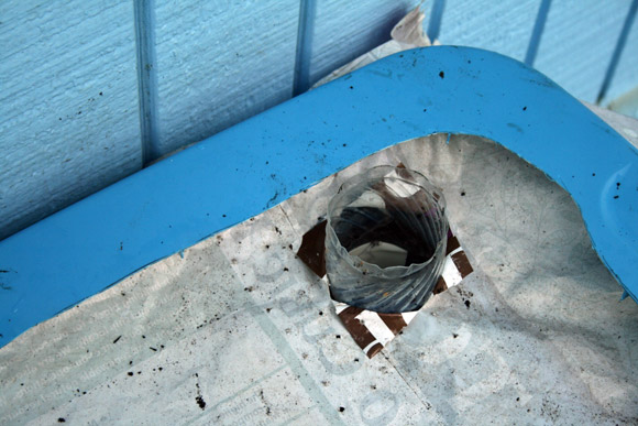 earthbox : hole for the watering bottle