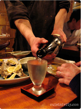 waiter pouring sake for me