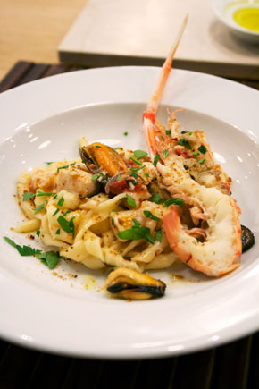 Sicilian style fresh pasta with seafood and crispy anchovy flavored bread crumbs
