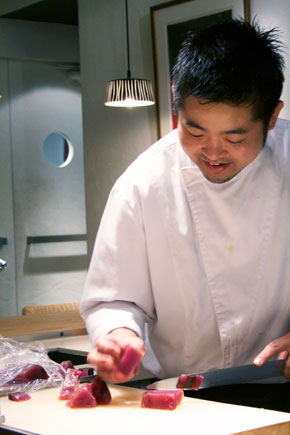 Executive chef at Biffi Teatro cutting fish