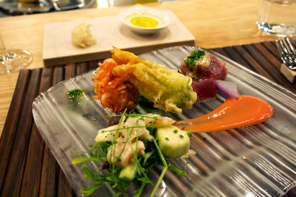 mirugai and shima cucumber salad, fried sea scallop with sakura ebi, fried stuffed zucchini flower with mozzarella and anchovy, Hatsu-gatsuo crudo with tomato sauce and Italian parsley sauce
