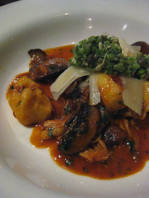 Pan-fried potato gnocchi with rabbit, portobellow mushrooms and green olive tapenade