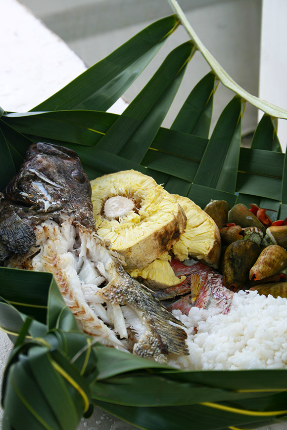 island meal in basket with grilled fish, bread fruits, coconut rice and boiled shell fish, Bikirin Island, The Marshall Islands