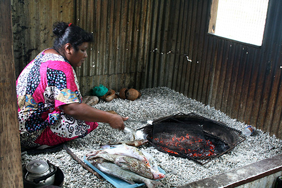 getting ready to grill fish, Bikirin Island, The Marshall Islands