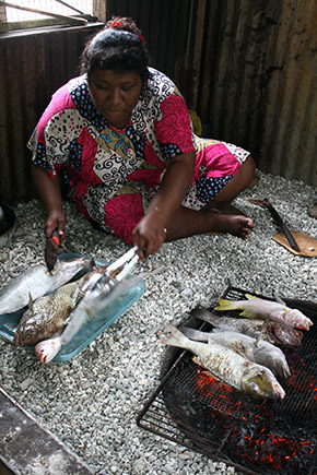 grilling fish, Bikirin Island, The Marshall Islands