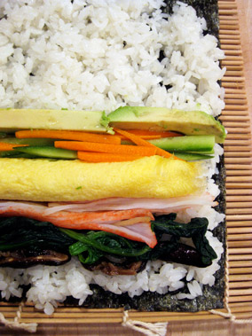 close up of laid out futo maki : before rolling