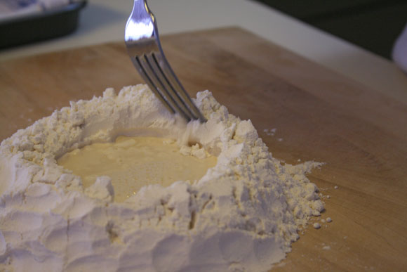 pasta dough : mixing flour into water