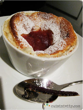 white chocolate souffle with cantaloupe and respberry sauce, candied beef jerky