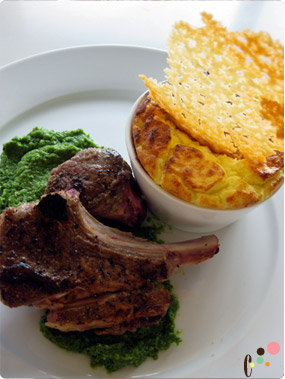 Pan seared lamb chps with pea puree, ricotta cheese souffle and parmesan chip