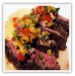 Chocolate marinade skirt stake with cantalope salsa